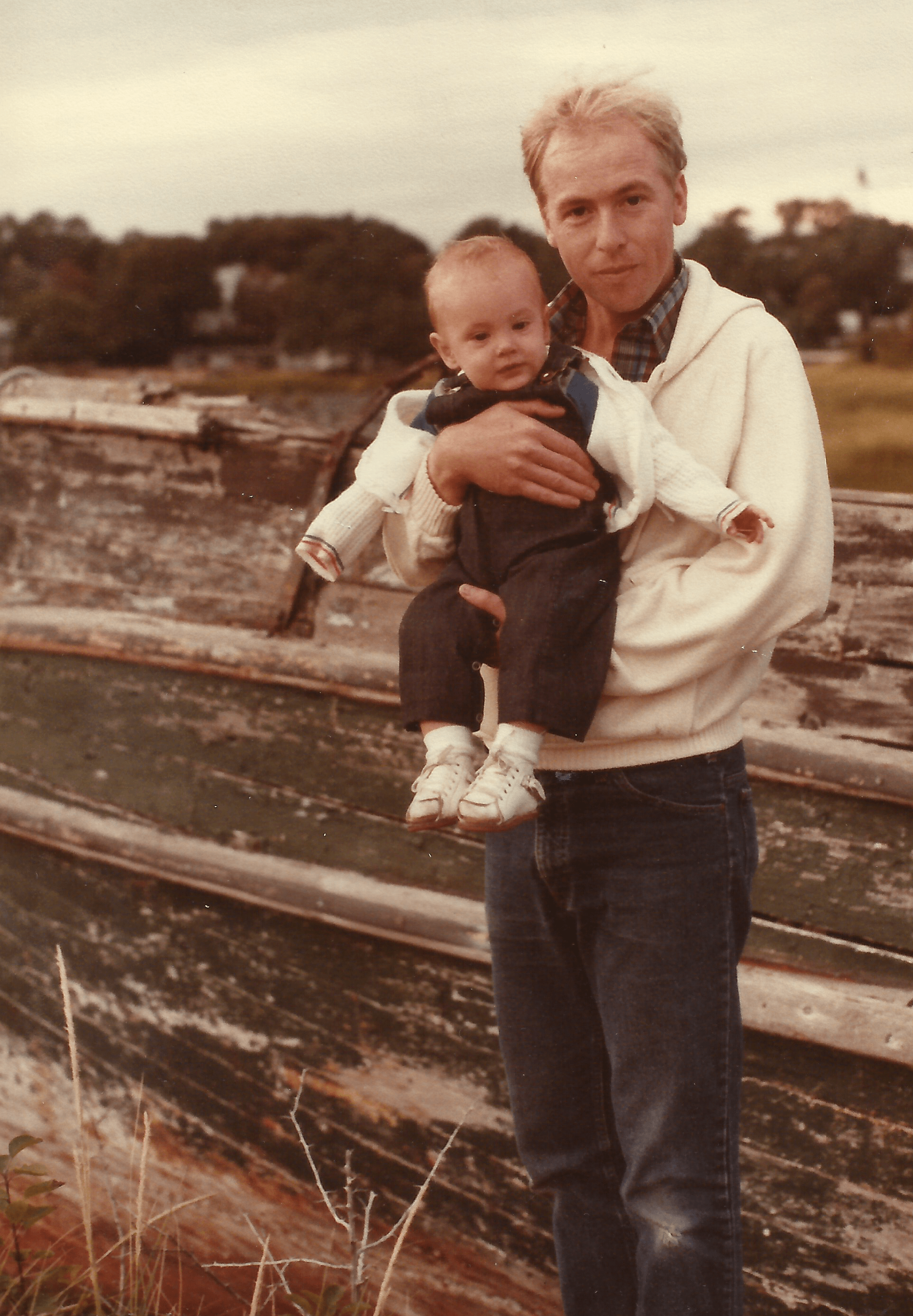Promotional photo of a young Dennis Dougherty holding his child